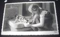 Photo Card, Girl feeding kitten, ca.1940